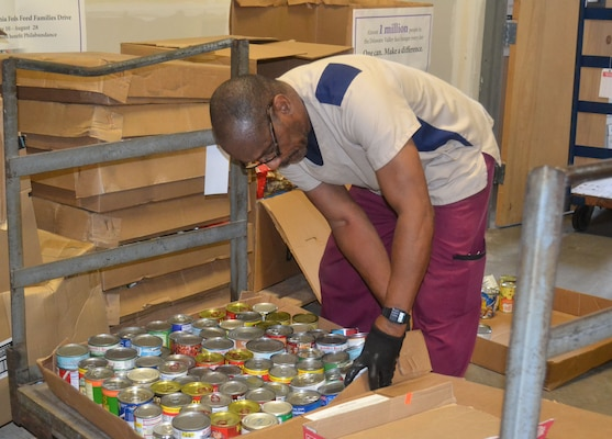 DLA Installation Services employee Leonard Shannon prepares donated food items for Philabundance days before they're delivered to one of the organization's drop-off centers in Philadelphia Sept. 15, 2015. Employees donated nearly 200 pounds beyond its 3,000-pound goal for this year's Feds Feed Families food drive.