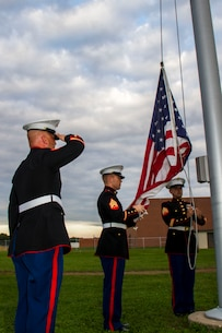 Marines from Recruiting Substation Central Michigan raise the United States flag during the H.H. Dow vs. Flint Southwestern football game, Sept. 18, 2015. The game was part of a Wounded Warriors Project fund drive.