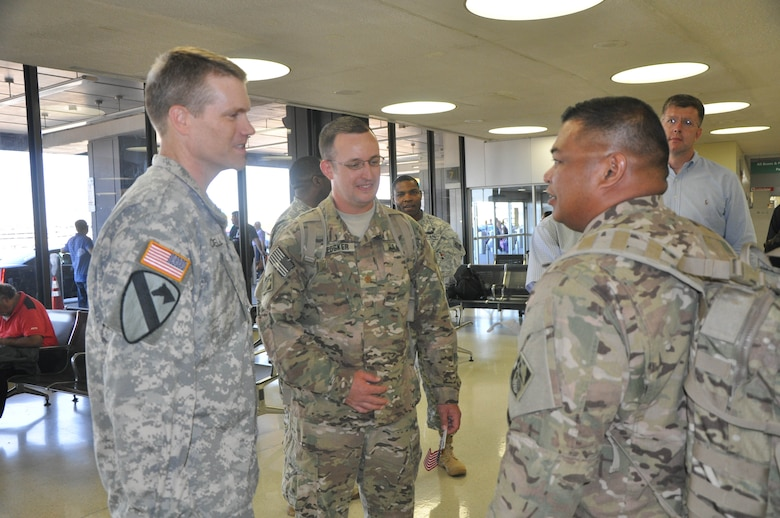 New York District Commander Col. David A. Caldwell (left) converses with SFC Roland Tajalle, right, at Newark Airport (NJ) just after the District's Forward Engineering Support Team - Advanced (FEST-A) returned from a nine-month deployment to Afghanistan completing over 60 projects for U.S. and Coalition forces with a design value exceeding $36 million. Also pictured are MAJ Brett Medsker, FEST-A Commander, center, and Sean O'Donnell,chief, emergency management/readiness, in background, right.