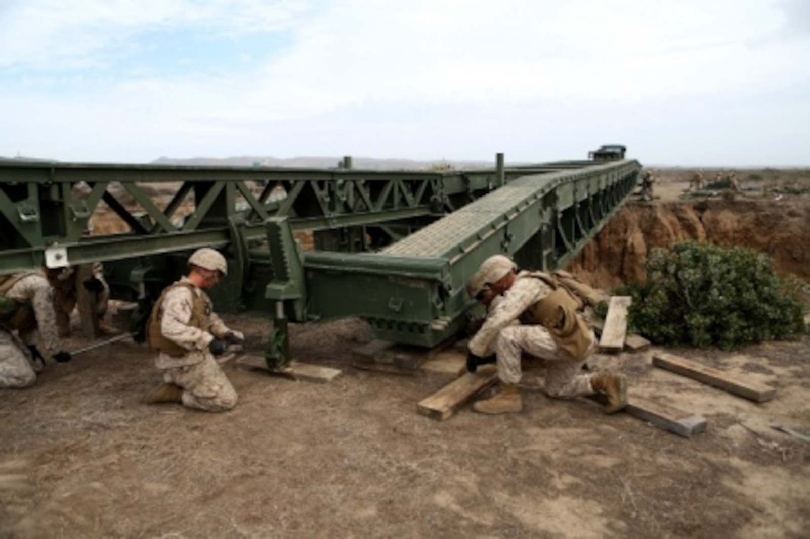 Engineers from Bridge Company, 7th Engineer Support Battalion, 1st Marine Logistics Group stabilize the end of a medium girder bridge aboard Camp Pendleton, Calif., Sept. 21, 2015. Marines from 7th ESB and 1st Combat Engineer Battalion are conducting various engineer training events alongside British Royal Engineers from the 54 Commando Squadron in coming weeks as part of annual large-scale exercise Black Alligator.