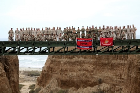 Engineers from Bridge Company, 7th Engineer Support Battalion, 1st Marine Logistics Group and 1st Combat Engineer Battalion, 1st Marine Division as well as members of British 54 Commando Squadron Royal Engineers stand atop a medium girder bridge they built aboard Camp Pendleton, Calif., Sept. 21, 2015. Marines from 7th ESB and 1st CEB are conducting various engineer training events alongside their British counterparts in coming weeks as part of annual large-scale exercise Black Alligator.
