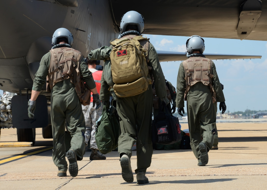 """A B-52 Stratofortress aircrew assigned to Air Force Global Strike Command makes its way to the aircraft before participating in exercise Immediate Response 2015 at Barksdale Air Force Base, La., Sept. 17, 2015. The exercise supports the goal of a """"strong Europe"""" by preparing partner nations to combine forces, ensuring unified security across allied nations. (U.S Air Force photo/Senior Airman Amanda Morris)"""