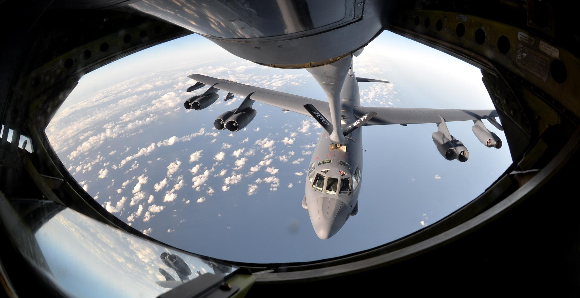 A B-52 Stratofortress from Barksdale Air Force Base, La., takes fuel from a KC-135 Stratotanker assigned to the 100th Air Refueling Wing at RAF Mildenhall, England, Sept. 18, 2015, in the skies near Spain. The refueling was part of exercise Immediate Response, which included a three-ship formation of KC-135s delivering a total of 180,000 pounds of fuel to the sole bomber. The KC-135 was designed and built during the Cold War specifically to deliver fuel to the B-52. (U.S. Air Force photo/Tech. Sgt. Austin M. May)