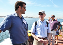 Off the shoreline of Coney Island, N.Y during a Harbor Inspection aboard the DCV Hayward in September 2015. Bill Shaldel (left) CEO of Shadel Environmental, speaks with Paul Tumminello, Chief of New York District's Civil Works Branch, as Anthony Ciorra, Chief of Coastal Restoration Branch looks on.