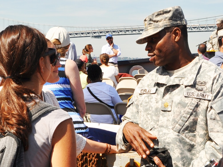 Maj. James Curlee, prospective Deputy Commander, Army Corps' New York District interacts with partners during a Harbor Inspection held in September 2015 aboard the DCV Hayward.