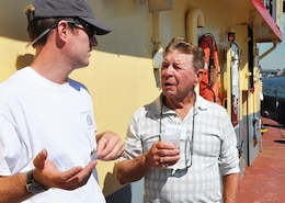 (r-l) Dan Mundy, Sr., of Jamaica Bay Ecowatchers discusses marsh islands restoration in Jamaica Bay with Peter Malinowski, New York Harbor Foundation during Harbor Inspection in September 2015 aboard the DCV Hayward.