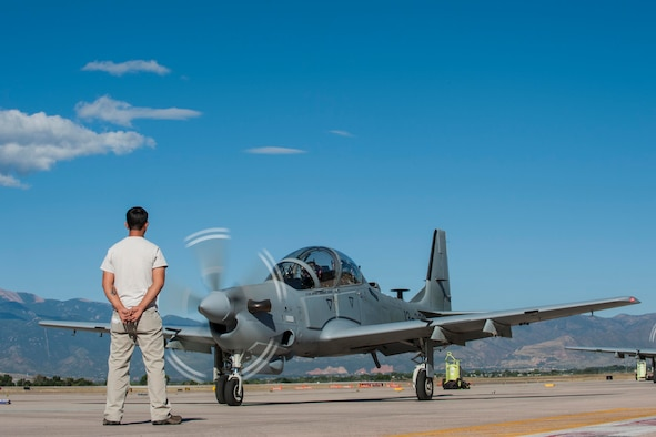 An Afghan maintainer waits as an 81st Fighter Squadron instructor pilot and Afghan pilot get ready to take off for high-altitude training at Peterson Air Force Base, Colo., Sept. 16, 2015. Afghan pilots have been training with the 81st FS at Moody AFB, Ga., with A-29B Super Tucanos and came to Peterson for the high-altitude and mountainous terrain training. (U.S. Air Force photo/Airman 1st Class Rose Gudex)