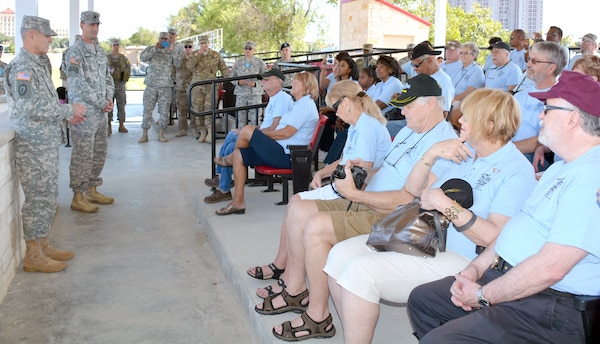 Maj. Gen. Steve Jones (left), commanding general, US Army Medical Department Center and School, US Army Health Readiness Center of Excellence and Sgt. Maj. Andrew Rhoades, AMEDDC&S, HRCoE,  welcome Vietnam War era medics, who served with Company C, 23rd Medical Battalion, Americal Division, to Fort Sam Houston and thank them for their legacy and contributions taking care of wounded comrades during the Vietnam War.