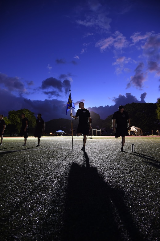 U.S. Air Force Master Sgt. Kurt Ward,  first sergeant from the 25th Air Support Operations Squadron, stretches before a formation run at the end of the 24-hour Prisoner of War and Missing In Action remembrance run on Joint Base Pearl Harbor-Hickam, Hawaii, Sept. 18, 2015. The 24 hour POW/MIA remembrance run was organized by the 25th Air Support Operations Squadron as a part of POW/MIA week and National POW/MIA Day. Every year the nation pauses on the third Friday of September to remember the sacrifices and service of prisoners of war. There are 83,344 Americans still unaccounted-for across the Defense Department. (U.S. Air Force photo by Tech. Sgt. Aaron Oelrich/Released)