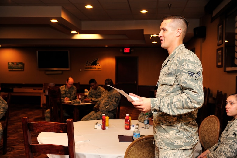 Senior Airman Dylan Vogel, 56th Medical Operations Squadron Family Health medical technician and the Luke Empowering Airmen's Development Council president, goes over the latest upcoming events during a LEAD Council meeting Sept. 16, 2015 at Luke Air Force Base, Ariz. Club Five Six. The LEAD Council has various programs available to help Airmen succeed, from the shadowing program to the scholarships provided and more. (U.S. Air Force photo by Senior Airman Grace Lee)