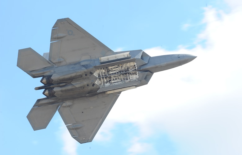 An F-22 Raptor reveals its internal weapons bay for spectators during an air show at Joint Base Andrews, Maryland, Sep. 18, 2015. The Raptor performs both air-to-air and air-to-ground missions allowing full realization of operational concepts vital to the 21st century Air Force. (U.S. Air Force photo by Senior Airman Bobby Cummings)