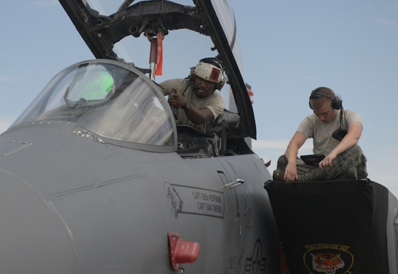 U.S. Air Force Senior Airman Edmund Aldridge, 391st Aircraft Maintenance Unit avionics journeyman points at a part in the F-15E Strike Eagle, July 23, 2015 at Nellis Air Force Base, Nevada. Edmund is one of many avionics technicians' who made sure the jets were operating correctly during Red Flag 15-3. (U.S. Air Force photo by Senior Airman Brittany A. Chase)