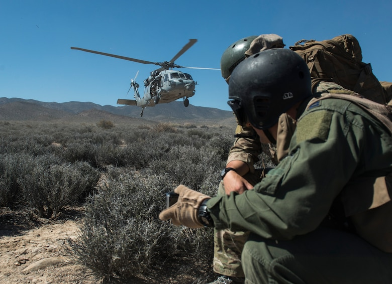 A Sikorsky HH-60 Pave Hawk prepares to land at the Nevada Test and Training Range, Nevada July 30, 2015. During Red Flag 15-3 the Pave Hawk was just one of multiple aircraft involved during a simulated rescue mission for a downed pilot.. (U.S. Air Force photo by Brittany A. Chase)