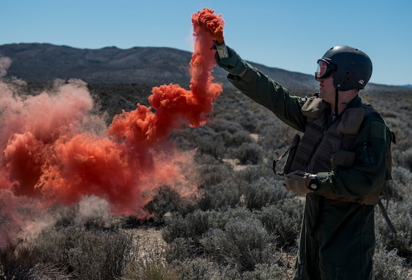 U.S. Air Force Capt. Jack Green, 480 Fighter Squadron F-16 pilot, signals aircraft using a flare Jul 30, 2015 at the Nevada Test and Training Range, Nevada. Green, who was simulating a downed pilot, was evaluated and trained by a SERE specialist during Red Flag 15-3. (U.S. Air Force Photo by Senior Airman Brittany A. Chase)