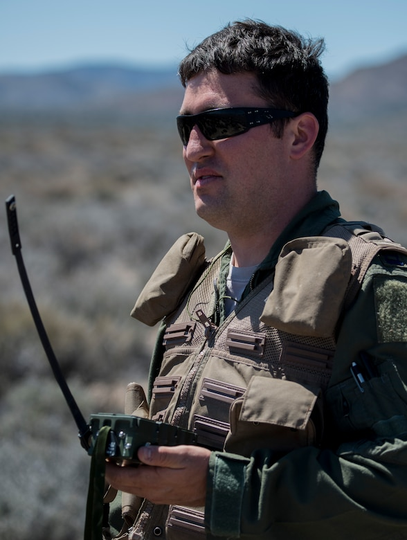 U.S. Air Force Capt. Jack Green, 480 Fighter Squadron F-16 pilot, holds a radio/signal transmitter July 30 at the Nevada Test and Training Range, Nevada. Green, who was simulating a downed pilot during Red Flag 15-3, used various methods to help pilots overhead pin-point his location in order to be saved.  (U.S. Air Force photo by Senior Airman Brittany A. Chase)