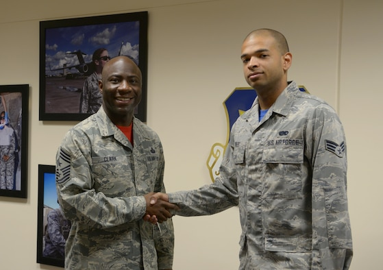 Chief Master Sgt. Vegas Clark, 39th Air Base Wing commander, poses for a photo with Senior Airman Derek Miles, 39th Operations Support Squadron Ground radar technician, upon meeting him for his chief shadow day Sept. 18, 2015, at Incirlik Air Base, Turkey. Airmen are chosen for chief shadowing based on recommendation from their leadership due to their dedication to the mission and their job. (U.S. Air Force photo by Senior Airman Krystal Ardrey/Released)
