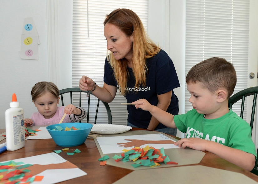 Amber Krofta, a Family Child Care provider, helps Anya Zamzow, right, and Michael Krohn, left, Sept. 21 during play time at her house where she cares for children. Family Child Care program is actively recruiting individuals in base housing who wish to become child care professionals. (U.S. Air Force photo by Jerry Saslav)