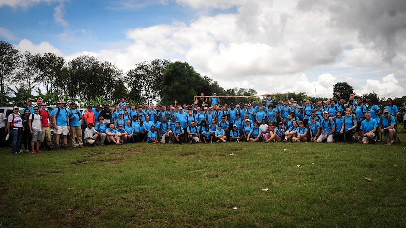 SOTO CANO AIR BASE, Honduras – Volunteers from Joint Task Force-Bravo, the Special Purpose Marine Air Ground Task Force, and the U.S. Embassy in Tegucigalpa pose for a photo following the 63rd JTF-Bravo Chapel Hike in Calavera Centro, Honduras, Sept. 19, 2015. This was the largest Chapel Hike on record, providing 11,500 pounds of donated food, clothing, linen, toiletries and school supplies to the remote villagers before the onset of winter. (U.S. Air Force photo by Capt. Christopher Love)