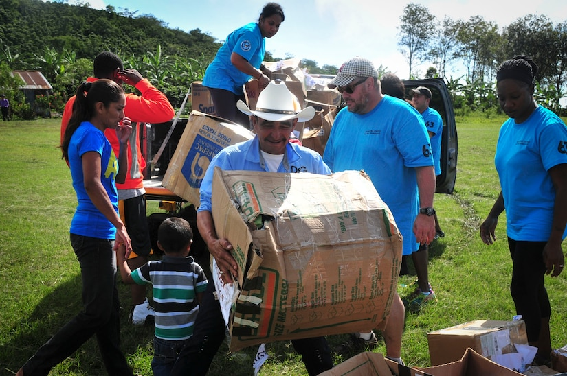 SOTO CANO AIR BASE, Honduras – A man from Calavera Centro, an agricultural community spread across a mountain in La Paz, Honduras, unloads a box of donated goods from a Joint Task Force-Bravo truck, prior to a Chapel Hike ceremony Sept. 19, 2015. The JTF-Bravo Chapel organizes these volunteer events to provide humanitarian assistance to those with material needs in remote regions of Honduras. (U.S. Air Force photo by Capt. Christopher Love)