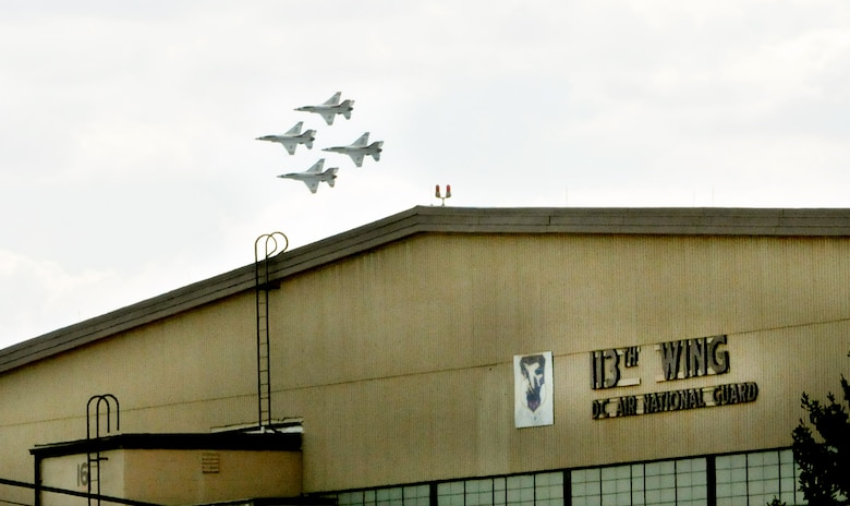 The USAF Thunderbirds air demonstration team performs a diamond formation above Joint Base Andrews, Md., as part of the Andrews Air Show Sept. 18. In the foreground is the 113th Wing, D.C. Air National Guard's maintenance hangar. (U.S. Air National Guard photo by Master Sgt. Craig Clapper)