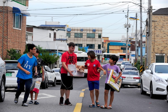 Children from a Welfare Facility pick out toys from a volunteer from Kunsan Air Base, Republic of Korea at Gunsan City, ROK, Aug. 18, 2015. Airmen from Kunsan AB visit the orphanage monthly to bolster relationships with the local community. (U.S. Air Force photo by Staff Sgt. Nick Wilson/Released)