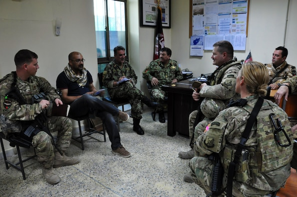 """Train, Advice, Assist Command – Air (TAAC-Air) Coalition advisors meet with Afghan Air Force wing operations center and Afghan command and control Center leaders Aug. 31, 2015.  This was the first Afghan-led exercise scenario coordinated and planned between the Kabul WOC and ACCC. The advisors were on-hand to ensure the AAF were on-track to achieve their goals, which were to test their communication flow between their two agencies and their ability to task and launch recovery """"exercise"""" aircraft for a """"downed"""" aircraft. (U.S. Air Force photo by Capt. Eydie Sakura/released)"""