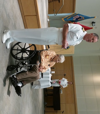 Navy Capt. Christopher Mosher, DLA Troop Support Subsistence director, presents John Bulovas, a former World War II POW, with a token of appreciation for sharing his experience during the Philadelphia Compound Veterans Committee's annual POW/MIA Remembrance ceremony Sept. 15 in Philadelphia. Bulovas was captured in 1943 by German forces and was liberated in 1945.