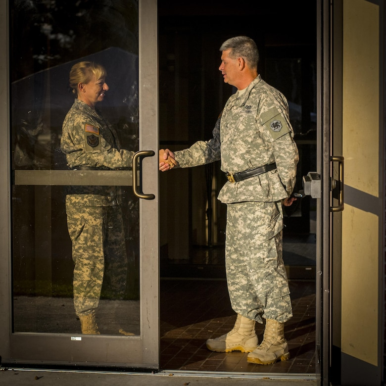 Army Reserve Maj. Gen. Leslie Purser, outgoing commander of the 108th Training Command (Initial Entry Training), shakes hands with Maj. Gen. Mark McQueen, the incoming commander, before walking onto the parade field for their change of command ceremony at Fort Jackson, S.C., Sept. 20, 2015. (U.S. Army photo by Sgt. Ken Scar)