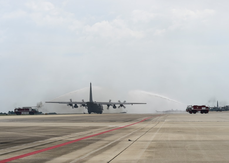 "An AC-130U Spooky taxis under a water arch before its retirement flight at Hurlburt Field, Fla., Sept. 21, 2015. The AC-130U Spooky ""Bad Omen"" is the first ""U"" model to retire to the Bone Yard at Davis-Monthan Air Force Base, Az. ""Bad Omen"" was delivered to Hurlburt Field on Feb. 17, 1995, during which time it flew more than 2,300 sorties with approximately 5,600 landings and more than 10,000 hours of flight time.  (U.S. Air Force photo by Airman Kai White)"