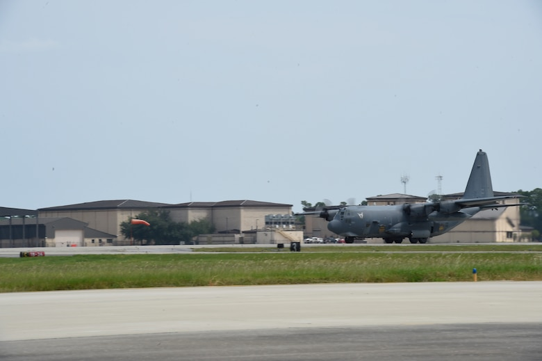 "An AC-130U Spooky takes off for its retirement flight at Hurlburt Field, Fla., Sept. 21, 2015. The AC-130U Spooky ""Bad Omen"" is the first ""U"" model to retire to the Bone Yard at Davis-Monthan Air Force Base, Az. ""Bad Omen"" was delivered to Hurlburt Field on Feb. 17, 1995, during which time it flew more than 2,300 sorties with approximately 5,600 landings and more than 10,000 hours of flight time.  (U.S. Air Force photo by Airman Kai White)"