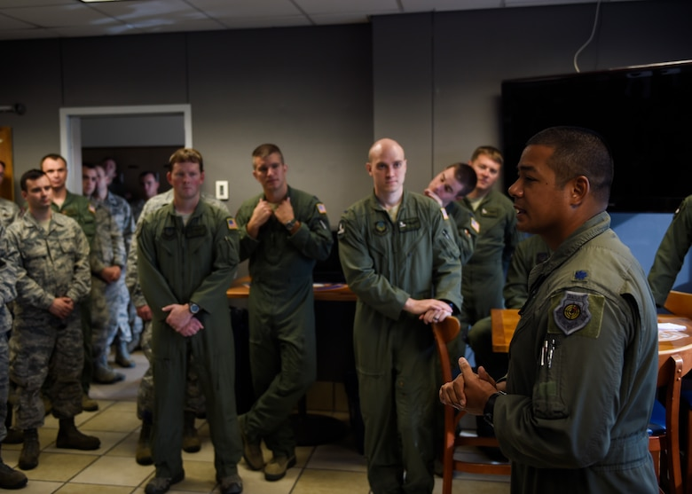 """Lt. Col. Derrick Barton, 4th Special Operations Squadron commander, speaks at the first AC-130U Spooky retirement at Hurlburt Field, Fla., Sept. 21, 2015. On July 21, 2011, """"Bad Omen"""" had one of its most successful sorties over Afghanistan. The aircraft arrived on station to support a task force that was infiltrating a compound area when the task force started taking fire from all sides. The gunship began to take direct action, and true to """"U"""" model form, the crew performed eight separate engagements using infrared and TV dual-target attacks firing 146, 40mm cannon rounds and 41, 105mm howitzer rounds to end the engagement. (U.S. Air Force photo by Airman Kai White)"""