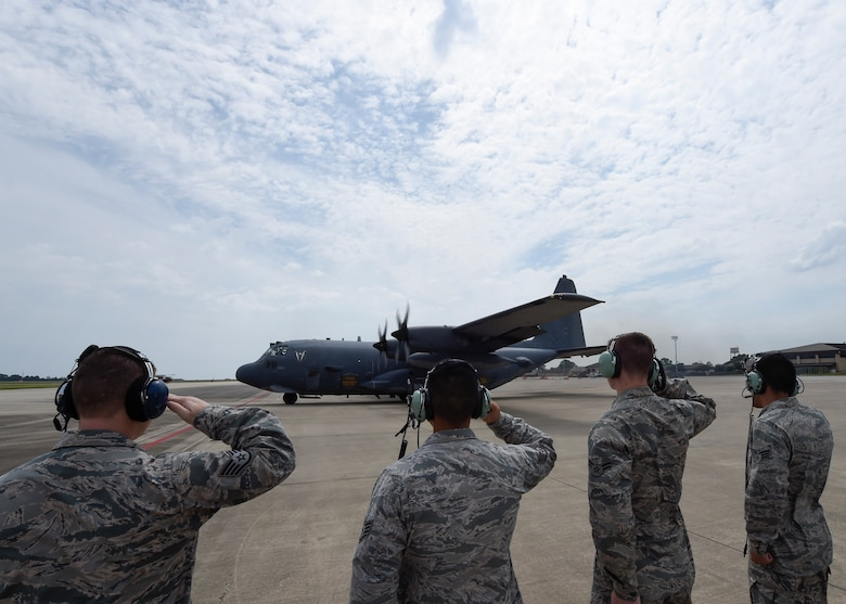 "Airmen with the 1st Special Operations Aircraft Maintenance Squadron render a final salute to an AC-130U Spooky before its retirement flight at Hurlburt Field, Fla., Sept. 21, 2015. Tail number 0163, ""Bad Omen,"" was retired Sept. 21, 2015, after more than 20 years of service. ""Bad Omen"" last deployed to Bagram Airfield, Afghanistan in December 2013 where it accumulated approximately 600 combat hours and flew more than 100 sorties. (U.S. Air Force photo by Airman Kai White)"
