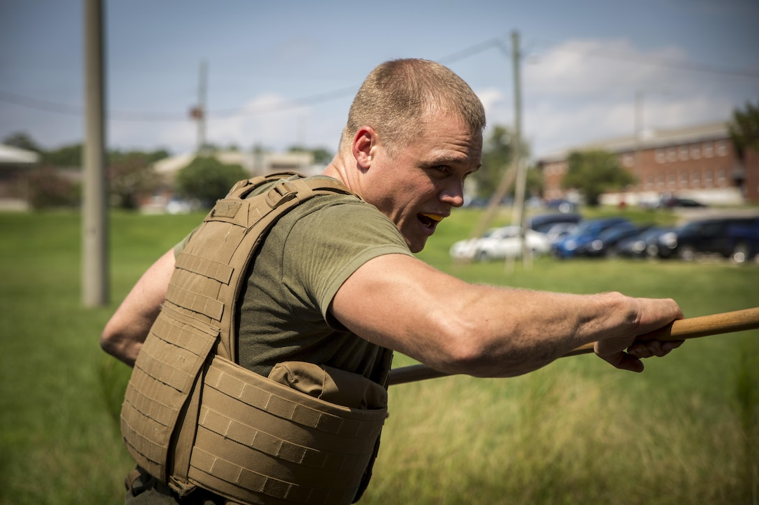 A sailor with 2nd Dental Battalion, 2nd Marine Logistics Group practices bayonet techniques during a Marine Corps Martial Arts Program course aboard Camp Lejeune, N.C., Sept. 11, 2015. The MCMAP course was part of a week-long training event where the sailors also conducted combat lifesaving and tactical casualty care training. (U.S. Marine Corps Photo by Cpl. Chelsea D. Toombs/Released)