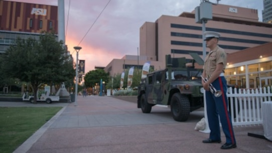 Cpl. Drew Blincoe takes his position at the center of Civic Space Park in Phoenix, Sept. 9, 2015, before sounding reveille as part of Marine Week Phoenix. Marine Week Phoenix gives the people of Phoenix an opportunity to see Marine Corps history, traditions and values.