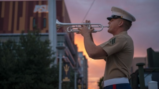 Cpl. Drew Blincoe plays morning reveille at Civic Space Park in Phoenix, Sept. 9, 2015, part of Marine Week Phoenix. Marine Week Phoenix gives the people of Phoenix an opportunity to see Marine Corps history, traditions and values.
