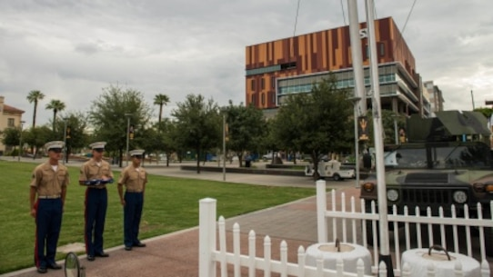 A Marine Corps color guard prepares to raise the colors at Civic Space Park on Sept. 9, 2015, as part of Marine Week Phoenix. This event allows the Marine Corps to showcase its traditions, history, and values.