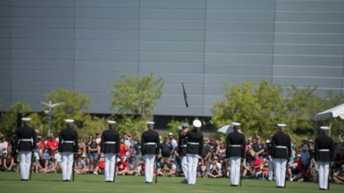 The United State Marine Corps Silent Drill Platoon demonstrates its precise rifle manual at the fields behind the University of Phoenix Stadium at Glendale, Arizona, Sept. 11, 2015. The demonstration was part of Marine Week Phoenix, which allows the Marine Corps to showcase its traditions, history, and values.