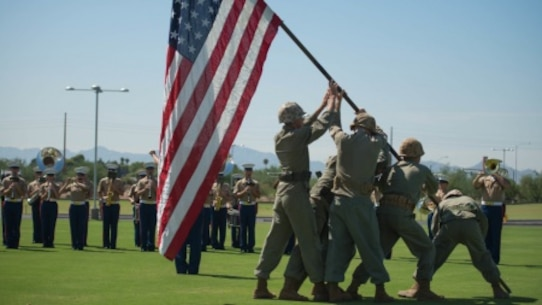 A group of Marine role players reenact the flag raising on Iwo Jima at the fields behind the University of Phoenix Stadium at Glendale, Arizona, Sept. 11, 2015. The demonstration was part of Marine Week Phoenix, which allows the Marine Corps to showcase its traditions, history, and values.