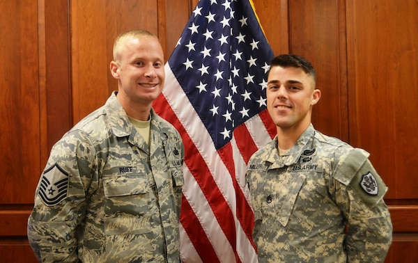 "Air Force Master Sgt. Woodrow Ruff (left) and Army Staff Sgt. Brandon Miller (right) were selected July 27 as DLA Senior and Junior NCO of the Third Quarter, respectively. DLA Troop Support Chief of Staff Robert Ratner hailed Ruff and Miller as two of the organization's ""best and brightest."""