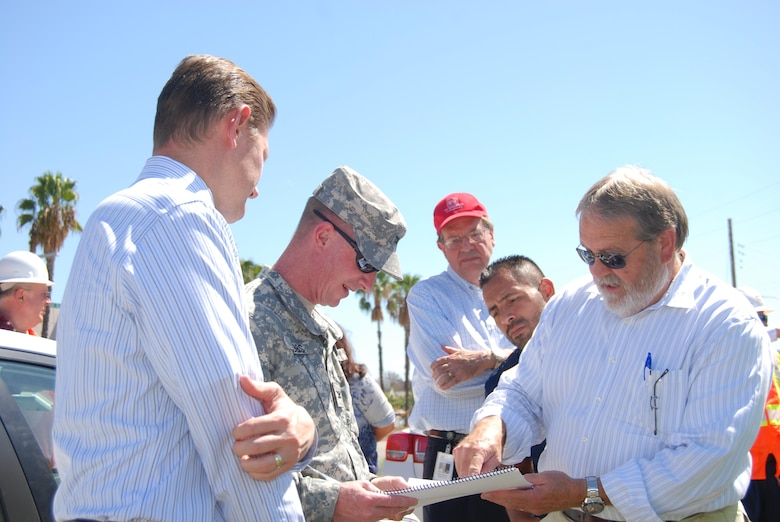 Dusty Williams (right), general manager and chief engineer of the Riverside County Flood Control & Water Conservation District, describes potential recreational aspects associated with the Murrieta Creek project to Col. Kirk Gibbs, during a Sept. 23 visit. Observing from left are David Van Dorpe (the district's deputy for programs and project management), Rick Leifield (the district's chief of engineering) and Jose Rocha (the Corps' lead engineer on the project.