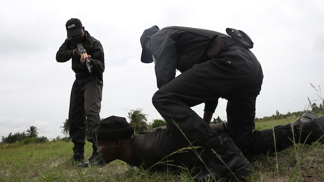 U.S. Marines and sailors accompanied Benin's National Surveillance Police to Jesu Jro, Benin, Sept. 24, 2015, to conduct a combined border surveillance training exercise. The Marines and sailors with the Special-Purpose Marine Air-Ground Task Force Crisis Response-Africa came to Benin for a monthlong theater security cooperation mission to build the NSP's capacity to counter illicit trafficking along the country's borders.