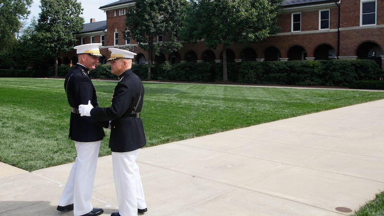 Gen. Robert B. Neller, right, and Joseph F. Dunford, Jr., shake hands following their passage of command ceremony at Marine Corps Barracks Washington, D.C., Sept. 24, 2015. Gen. Dunford, 36th and former Commandant of the Marine Corps, relinquished the position to Gen. Robert B. Neller, the 37th and new Commandant of the Marine Corps.