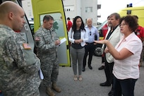 Left to right, Army Pfc. Carl Youngblood, a civil affairs specialist, Army Maj. Kevin Kaufman, chief of the civil affairs planning team, both with 457th Civil Affairs Battalion, 7th Civil Support Command and Diana Marsic, a U.S. Embassy-Croatia liaison/ Humanitarian Assistance project coordinator meet with Croatian medical personnel while assessing European Command's Humanitarian Assistance funded defibrillators and medical equipment, Sept. 11, 2015, in Split, Croatia. They met with Dr. Leo Luetic, chief physician and the director of the Institute for Emergency Medicine Split-Dalmatian County, and Dr. Radmila Majhen Ujevic, a physician at the Institute.