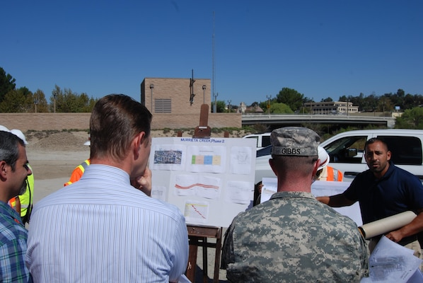 Jose Rocha (right), the Corps' lead engineer on the Murrieta Creek project, describes its current status to Los Angeles District Commander Col. Kirk Gibbs, during a Sept. 23 visit to the project. The visit included discussions with Dusty Williams, the general manager and chief engineer of the Riverside County Flood Control & Water Conservation District, about the ongoing work in the channel and the goals and obstacles to providing long-term flood risk reduction for the area's residents and businesses.