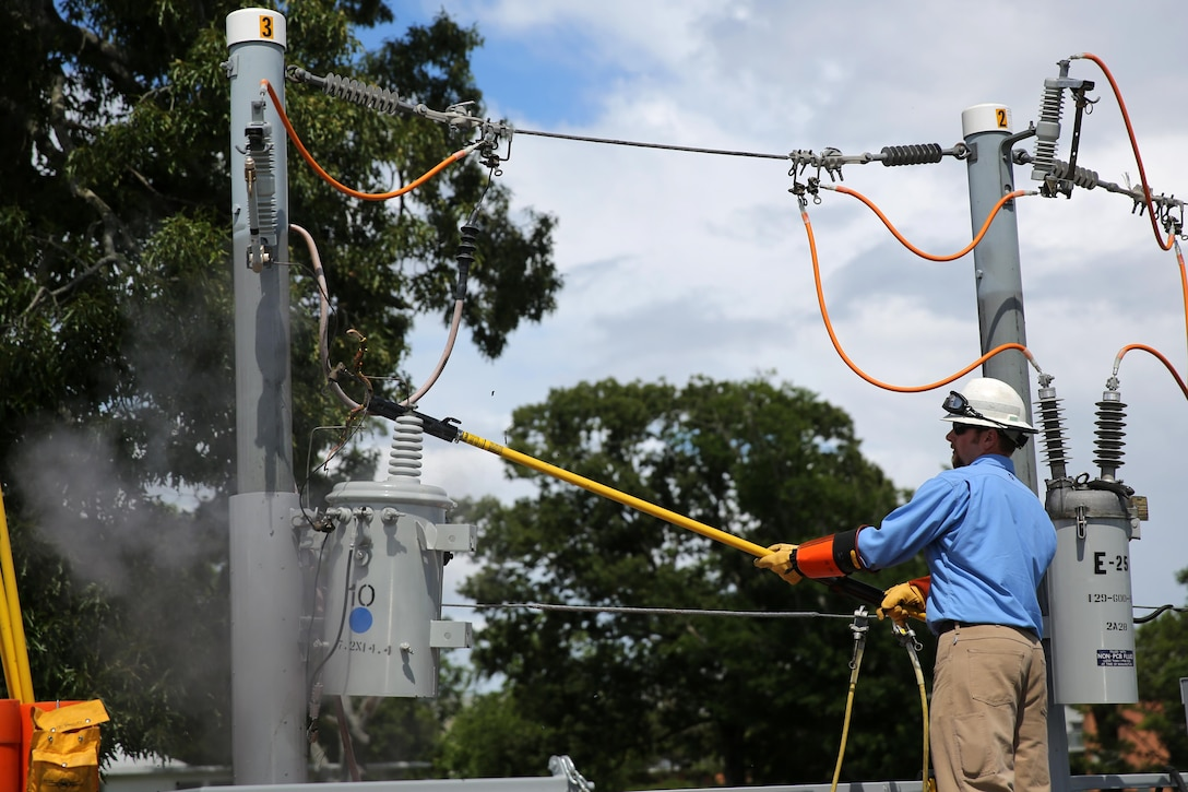 An electrical worker demonstrates the damage an active power line can cause during a demonstration drill at Marine Corps Air Station Cherry Point, N.C., June 4, 2015. September is National Preparedness Month, a time where emergency safety is highlighted across the air station. The Cherry Point Fire and Emergency Services and the Public Works Departments are among the many that go out to local communities to educate them on safety procedures and protocols that can prevent and potentially aid them during emergency situations. (U.S. Marine Corps photo by N.W. Huertas/Released)
