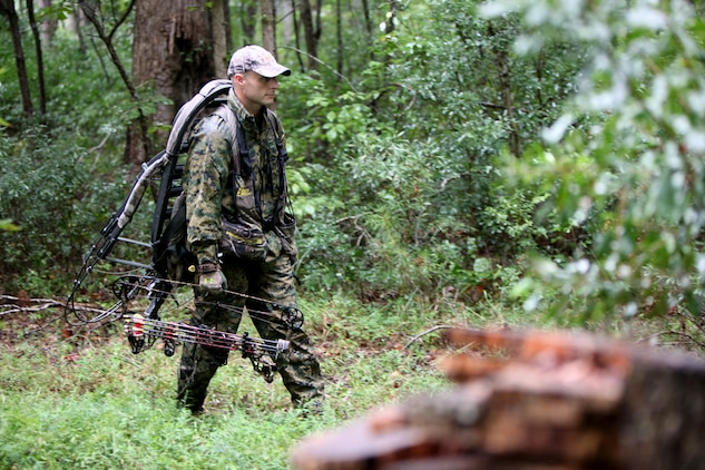 Gunnery Sgt. Jeffrey Short walks behind the tree line toward his hunting area with a crossbow during archery hunting season at Marine Corps Air Station Cherry Point, N.C., Sept. 22, 2015. Hunting on Cherry Point is open to active duty personnel, their dependents, retirees, DOD employees and sponsored guests. Short is the Air Combat Intelligence company gunnery sergeant for Marine Wing Headquarters Squadron 2. (U.S. Marine Corps photo by Lance Cpl. Jason Jimenez/Released)
