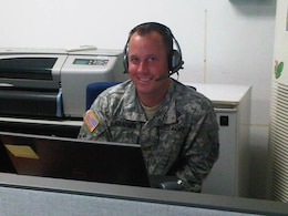 Maj. B.J. Kraemer, POF Operations Center OIC, conducts a coordination call as part of the USACE-Far East District's participation in the U.S. Forces Korea exercise, Ulchi Freedom Guardian (UFG) 15.