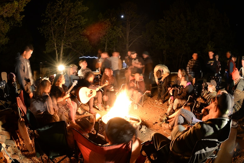 U.S. service members sit around a campfire playing instruments, roasting marshmallows and drinking hot chocolate at Mather Camp Ground along the South Rim of Grand Canyon National Park Sept. 19, 2015. The service members were at the canyon as part of the 2015 Grand Canyon Breakaway Weekend. (U.S. Air Force photo by Airman 1st Class Ashley N. Steffen/Released)