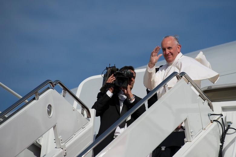 Pope Francis waves to the crowd gathered at Joint Base Andrews, Sept. 24, 2015 as he prepares to depart for New York. The pope will also visit Philadelphia during his U.S. trip before returning to Rome Sept. 27. (U.S. Air Force photo/Tech. Sgt. Robert Cloys)