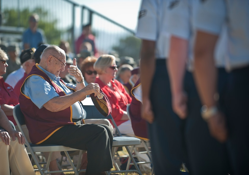 A former prisoner of war wipes his face during the Prisoners of War/Missing in Action Recognition Ceremony at Nellis Air Force Base, Nev., Sept. 18, 2015. Many former POWs and military veterans joined Nellis AFB Airmen in honoring the nation's POWs and those MIA. (U.S. Air Force photo by Staff Sgt. Siuta B. Ika)